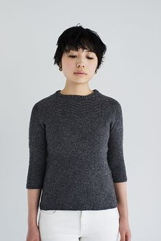 A well-fitted pullover with elbow length sleeves and feminine tailored shape. Knit from the bottom-up, the arrow patterns on the top front are a treat! This pullover will look great in either neutral colors or bright colors. The soft fabric of LOFT makes Arrow super comfortable to wear.