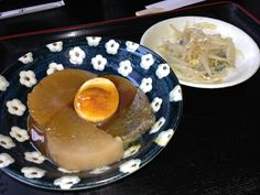 oden (various ingredients, such as egg, daikon, or konnyaku stewed in soy-flavored dashi)