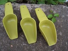 These are the best scoops I always pick them up when I see them out!  Vintage Tupperware Gadgets Scoops in Avocado