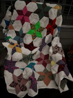 A Star Quilt Afghan, crocheted from mostly scrap yarn, that sat in a basket nearly complete twice over the past couple of years or so.