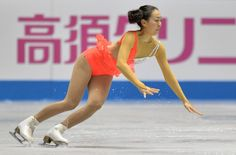 Japan's Mao Asada falls on the ice during her performance in the women's short program at the World Team Trophy figure skating competition in Tokyo on April 11, 2013.