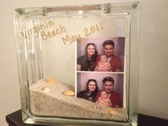 Glass block, filled with beach sand and shells and a pic from that years vacation. Use sharpie paint pen to write on (It comes rite off w/ alcohol swab)
