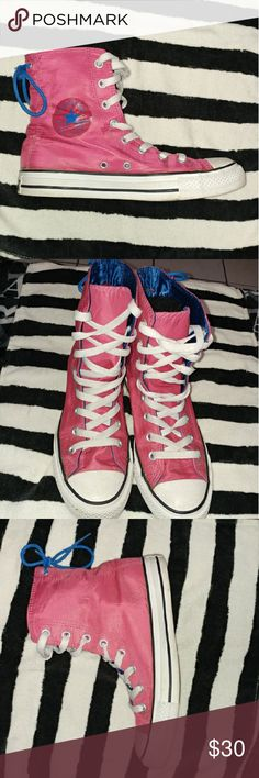 Fuchsia Converse Rubber-ish Material. Inside is a royal blue kinda shiny. Has a blue lace in back. They're practiaclly new gently used. In great condition. Converse Shoes Athletic Shoes