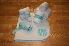 Teal Vines Circle Monogram Full Set, $85.00 by KLMequestrian. Show off in this complete gift set for you and your horse! Customized with your monogram on the saddle pad. 1 Monogrammed saddle pad with circle applique . 4 Standing wraps (horse or pony size), 4 Polo wraps (horse or pony size), 1 D-ring adjustable belt (adult or youth)