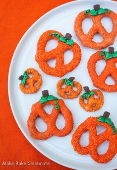 Chocolate Covered Pumpkin Pretzels.  If youre not going to Bake - its okay :)   Bake orange candy melts, orange non-pareils, orange edible glitter and tangerine candy crunch along with our royal icing mix and green gel color OR green candy writer can help you make these!