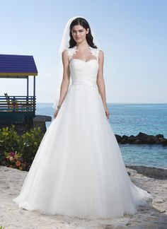 Sincerity wedding dress style 3773 Beautiful Bimini - Tulle ball gown features a Queen Anne neckline and  V-ruched bodice accented by a satin waistband with lace applique. Style  features lace back enclosed by satin buttons. Gown is finished with  chapel length train.