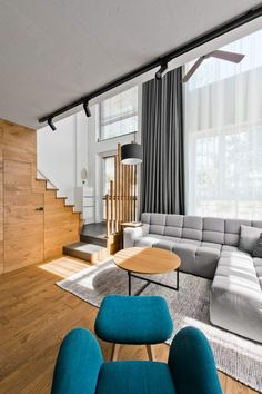 mobilier-scandinave-salon-canapé-angle-gris-tapis-gris-assorti