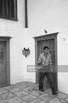 Leonard Cohen walking on a street near his vacation home in Hydra, Greece, October 1960.