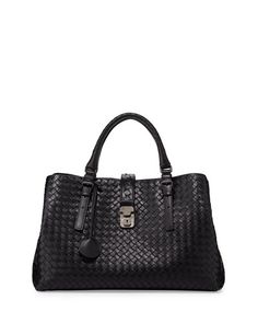 """Bottega Veneta signature hand-woven intrecciato leather tote. Burnished gunmetal hardware. Adjustable tote handles with square rings; 5 1/2"""" drop. Woven strap closure with locking clasp secures all co"""