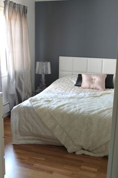 Bedroon with grey curtains @ Coconut White