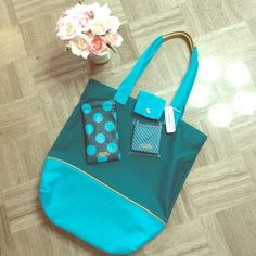 Charming Charlie bag set Teal and aqua blue charming Charlie tote bag, small travel mirror, and polka dotted sunglasses pouch. Gold colored details. Originally purchased for $120 with more items (small bags, umbrella, travel mug, journal). Beautiful bright color for summer! Trying to spring clean my closet! Offers welcome! Charming Charlie Bags Totes