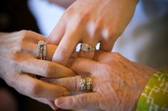 Sweet multi-generational wedding photo with the bride, mother, and grandmother...note their fingers intertwined.