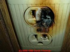 Photograph of an overheating aluminum-wired electrical outlet - thanks to J Simmons.   Aluminum wiring is cheaper than copper, but who wants to see THIS???