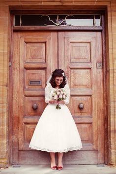 Cute vintage bride wearing a short wedding dress from Elizabeth Avey