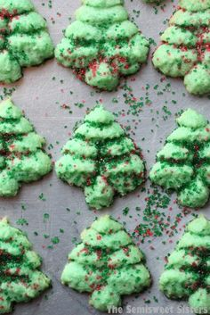Christmas Tree Spritz CookiesThese cookies are simple to make. You will need a cookie press to make them & the tree pattern disc. Be careful that you push out enough dough for each tree or it will not stick to the cookie sheet like it should. If the dough Christmas Tree Cookies, Christmas Sweets, Holiday Cookies, Holiday Treats, Holiday Recipes, Christmas Recipes, Christmas Foods, Christmas Ideas, Christmas Time