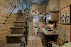 A cabin-style container tiny house.  I am IN LOVE with this tiny house***I just need the ceiling to be a tad higher in the loft & I am ready to move in****