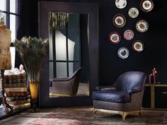 An Art Deco leather chair in the living room is a great place to start; the armchair is usually not the main focal point of the room and is instead off to the