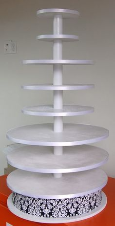 cupcake stand, pvc, and cake boards...like the quantity that can go on this one!  Dad could make this, right Andrea?