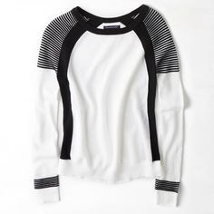 AEO White Black Colorblocked MOTO Crewneck Sweater Brand: American Eagle Outfitters Size: Large Color: White/Black  Material: 100% Cotton  This top is in great condition. It features a MOTO ribbed/striped design on the shoulders and the cuffs. The top is very lightweight with the white areas having a mesh look (but not feel) to it. The sides of the top are black and slimming, providing a nice feminine silhouette. Although called a sweater by AE, I'd consider this to be more of a shirt. It is…