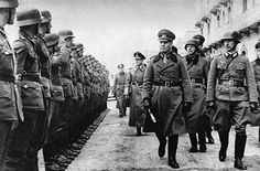 Erwin Rommel inspecting western German defenses. (1944) // I have a couple of questions to ask about this photo: #1 - Why is there only one guy saluting in the whole line-up? #2 - And why is he saluting AMERICAN style?