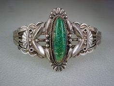 """OLD HARVEY/NAVAJO STAMPED STERLING SILVER & CARICO LAKE TURQUOISE BRACELET. This is a great old Fred Harvey era Navajo tourist market bracelet dating back to about the 1930s. It is sized for a medium/large wrist, the inside end-to-end measurement is 5 1/4"""" plus a 1 1/2"""" opening and 1 1/2"""" wide at center. 