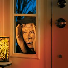 For a Halloween decoration that will make family and friends jump, try a scary peeper. He peers through your window, moving his eyes back and forth as if he is looking around inside.