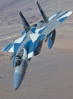 F-15C Eagle Aggressor pulling away from its tanker after mid-air refueling.