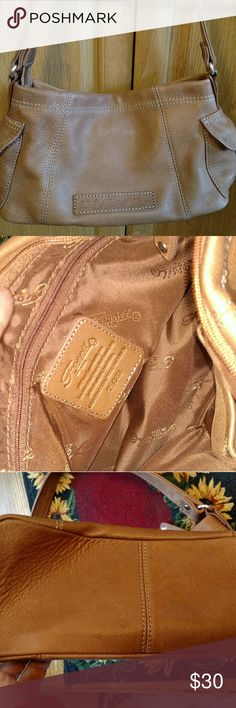 FOSSIL PURSE In new condition Fossil purse. Measures 13 x 7. Color is tan. Fossil Bags Shoulder Bags
