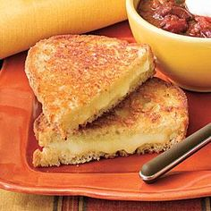Extra Cheesy Grilled Cheese Recipe | MyRecipes.com  I'd love to pair this with a good chunky soup! Maybe dress up the sandwiches with bacon or ham too :D