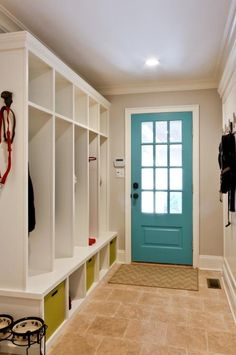 Mud room cubbies (annnnnd I love the color of door)