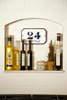 An Italian House Number Plaque Adds Charm To A Tiled Niche Photo