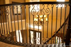 This staircase design was created using Endecor series balusters. The small spiral (16.7.1), medium spiral (16.7.2), and large spiral (16.7.3) create a uniquely designed staircase. These components are available in a Satin Black (shown), Oil Rubbed Bronze, and Vintage Brass powder-coated finish. We offer parts, install services, and custom components throughout Texas. Click the image for more information.