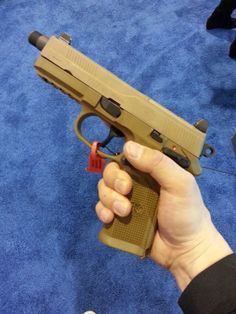 FNH's new FNX-45 Tactical in .45 has a pre-threaded 5.3″ barrel