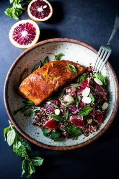 A healthy delicious recipe for Moroccan Salmon, paired with a Quinoa salad with orange, mint, almonds and olives. Simple, fast and easy.   www.feastingathome.com