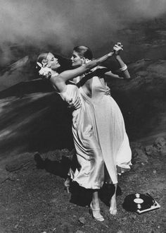 Cheryl Tiegs and Rene Russo dancing on a Hawaiian volcano. Photo: Helmut#Newton for Vogue.