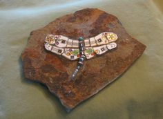 Nice dragonfly.  http://silvahayes.hubpages.com/hub/How-to-Mosaic-Garden-Stones