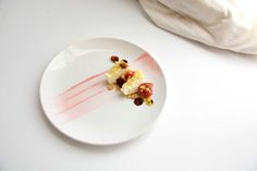 This dessert consist of a quark cloud cheesecake, vanilla cake, white wine poached rhubarb, rhubarb raspberry sauce, and crushed crumble langijo
