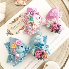 Handmade Seahorse Bow Materials: Made with glitter and sequin fabric, pearlescent marble leatherette and finished with mulberry flowers, a handmade clay charm and a bubble button. Size: The bow measures approximately 8cm. Clip or Headband: The bow can be attached to your choice of