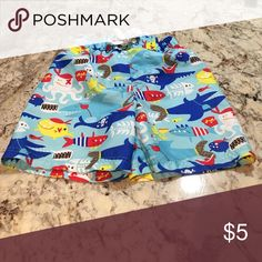 Boys swim trunks Blue with fish and sharks. Pirate themed jumping beans Swim Swim Trunks