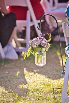 Mason jars filled with hydrangeas hung from shepherds hooks along the aisle. Photo by Rebekah J. Murray Photography; Flowers by Fleurish Events #weddings