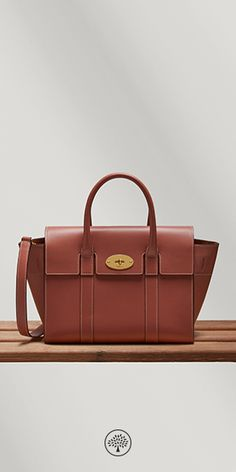 The Bayswater is a Mulberry icon and has been one of our most popular styles since it arrived in 2003. Now, over a decade later, Creative Director Johnny Coca has taken the iconic style and refined some key features to further enhance the beauty and practicality of its design. New branding has been added under the flap, a nod to those who prefer to wear a Bayswater with the flap tucked in.