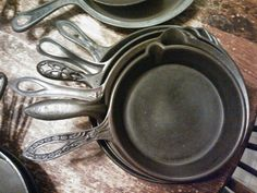"""Skillets/Frying Pans from mid to latter 1800's. Along with Kettles, Dutch Ovens, etc these were classified as """"Hollow Ware"""". Designs on some of the handles were for gripping and holes enable the handle to cool faster."""