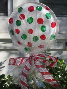 $ store lollipops for xmas decor Got it!!! Paper plates(glued/stapled together) Christmas colored markers, cellophane, stake of some sort and tie off with ribbon.