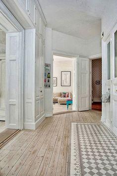 Hardwood floors and tile combination by Paola Navone for Tabarka Studio via Maria Victrix's blog