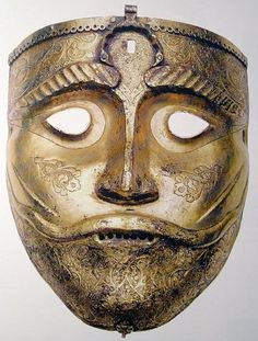 Persian helmet mask, this mask would have attached to a helmet by a hinge at the top of the mask, from the Persian exhibition in Poland, 15th century.