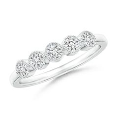 Milgrain-Edged Bezel Set Diamond Five Stone Ring. Embodying feminine charm and matchless beauty, this vintage-inspired five stone diamond ring will never go out of style.
