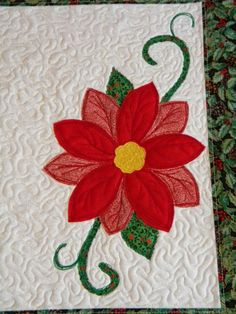free motion quilted, raw edge and thread art applique Christmas placemat, poinsettia
