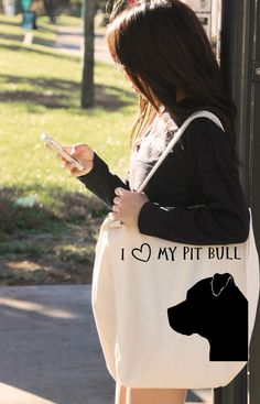 """We are proud to bring you the """"I LOVE MY PIT BULL"""" Tote Bag!  We want to show our support for this magnificent breed that has perfected the combination of goofy AND majestic!  Show off your love for this spectacular dog by purchasing this bag, or any Pit Bull or Staffordshire Terrier product.  10% of every sale will go directly to Pit Bull Rescue and Welfare Organizations! 
