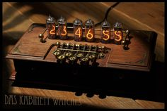 https://flic.kr/p/nNLJR1 | ~Timewriter~ Steampunk Nixie tube clock | I decided to make this Nixie clock inspired by old typewriters and the Enigma Machine. Everything is made from scratch, including the typewriter style keys.  All without the use of hightech machinery. The typewriter keys are fully functional, and are used to adjust time, date, preferences and temperature.
