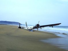 Old plane half sunk into a beach